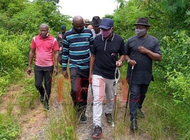 Okparaji, Victor and others touring overgrown streets in Ekporo Photo