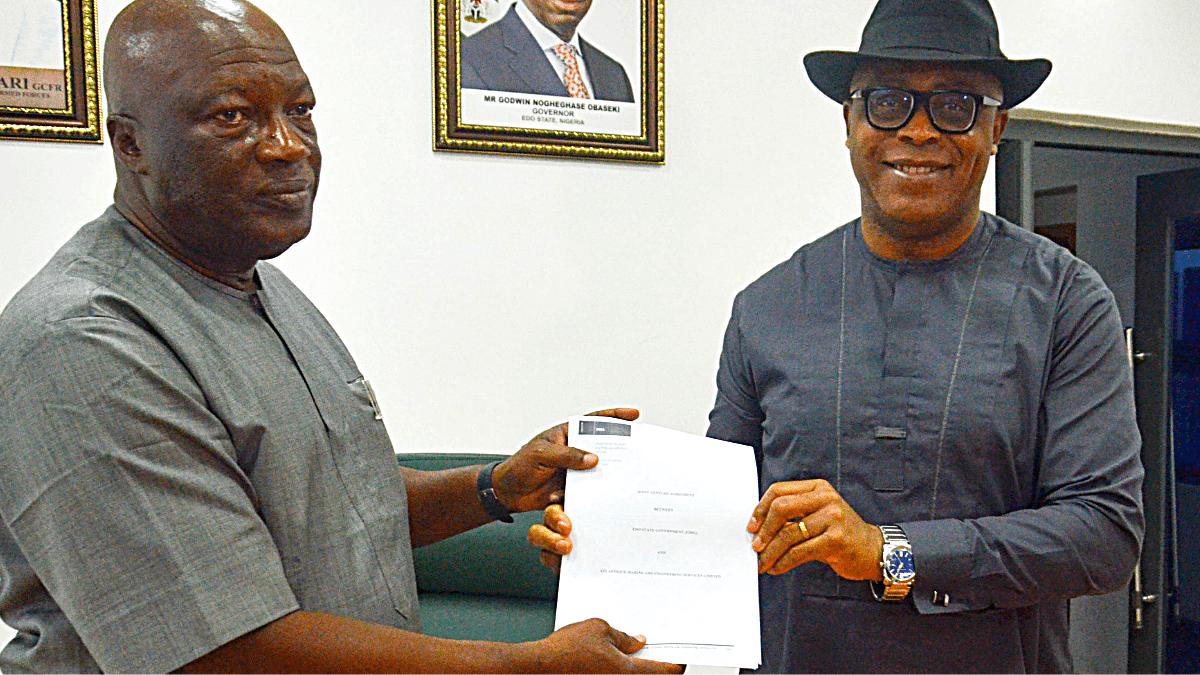 Ogie (left) and Akhigbe, after signing the agreement